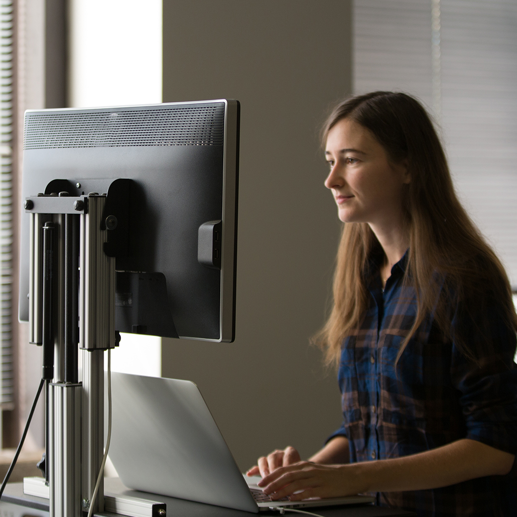 Woman in front of a computer monitor