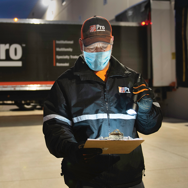 Driver checking his clipboard manifest