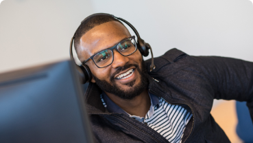 Man smiling while wearing a headset