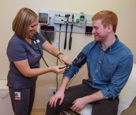 Nurse taking a man's blood pressure