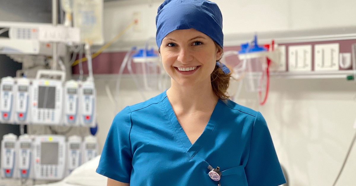 Smiling physician assistant in scrubs