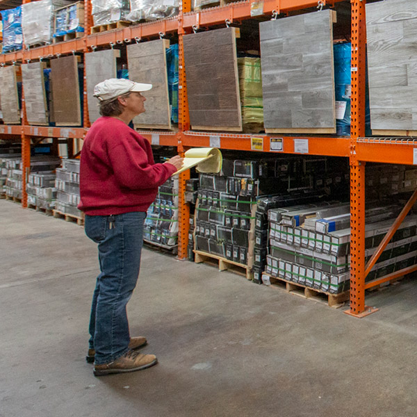 Contractor standing in front of pallettes in a Home Depot aisle