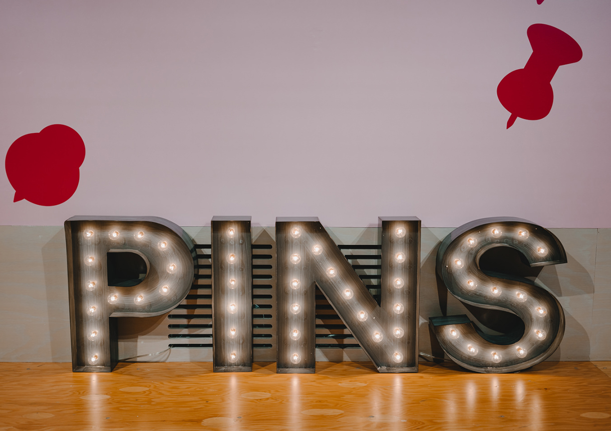 Decorative light letters that spell PINS.