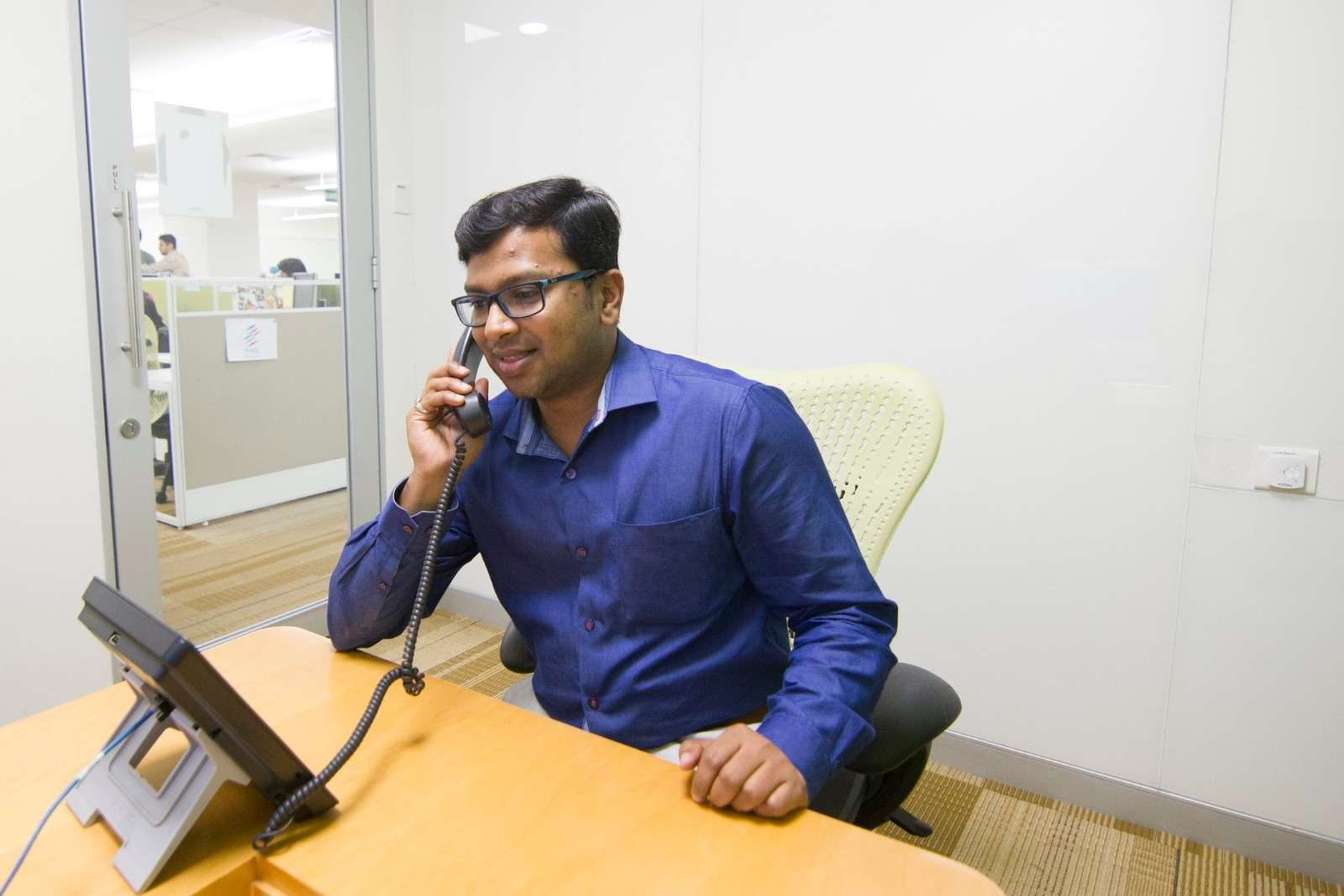 Employee on the phone in a private office