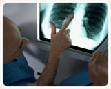 A male respiratory professional reading an X-ray