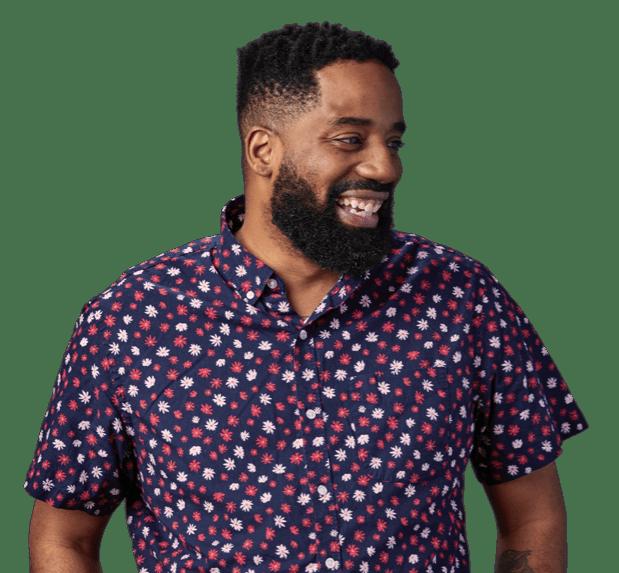Bearded man smiling in purple shirt