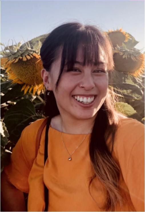 Shot of Filipino woman smiling at the camera.