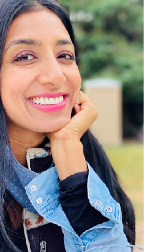 Woman smiling at the camera.