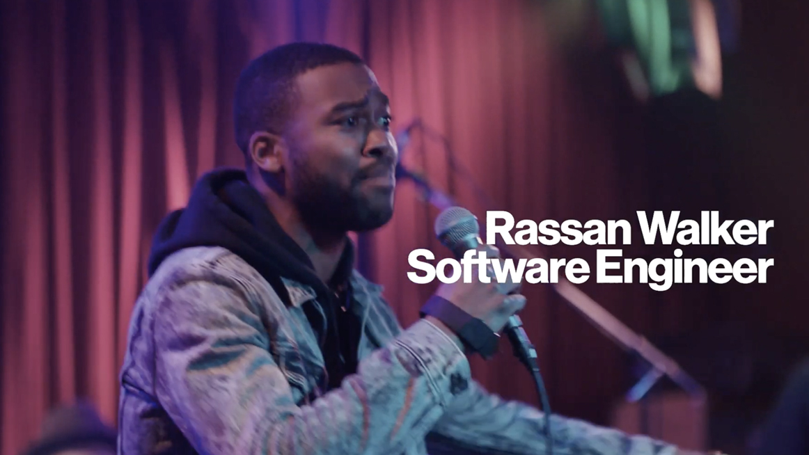 Screen cap from the Meet: Rassan video with a title caption that reads, Rassan Walker, Software Engineer.