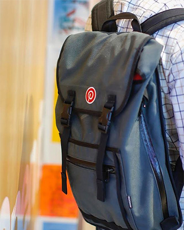 close up photo of a grey pinterest backpack