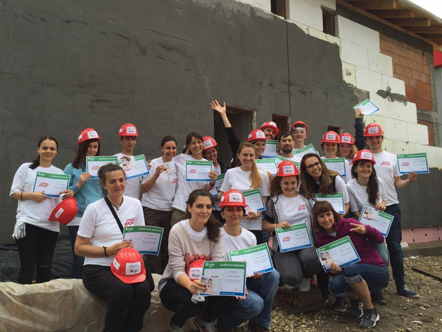 Group of ADP associates who volunteered to serve Habitat for Humanity in Romania.