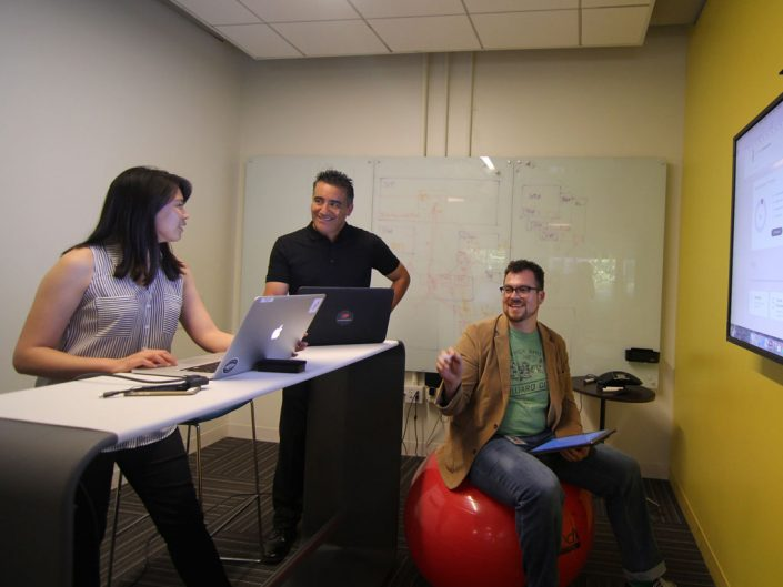 Small group of ADP employees collaborating in a small room
