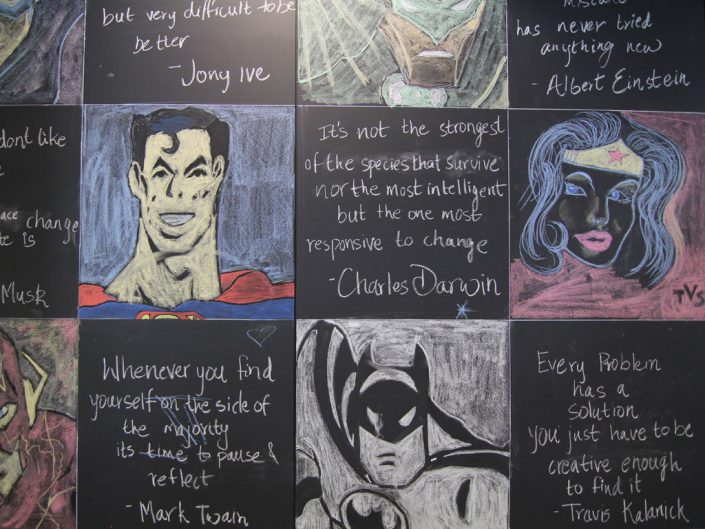Chalkboard illustration of superheroes and famous quotes from various people