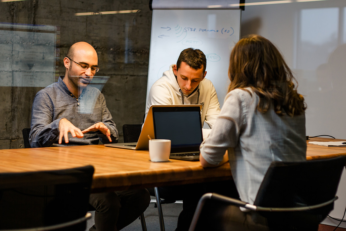 Group of associates collaborating at work