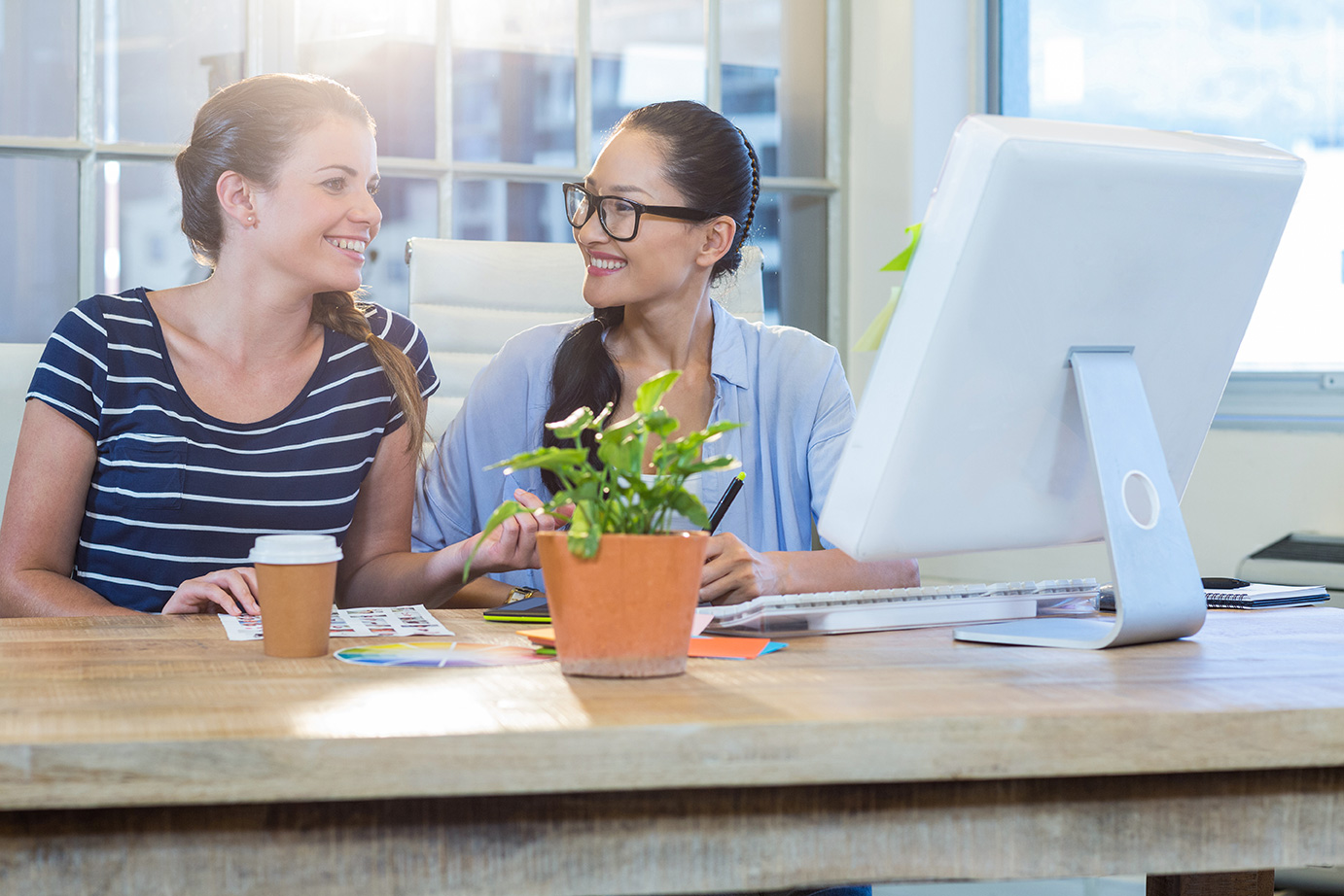 Two associates collaborating at work