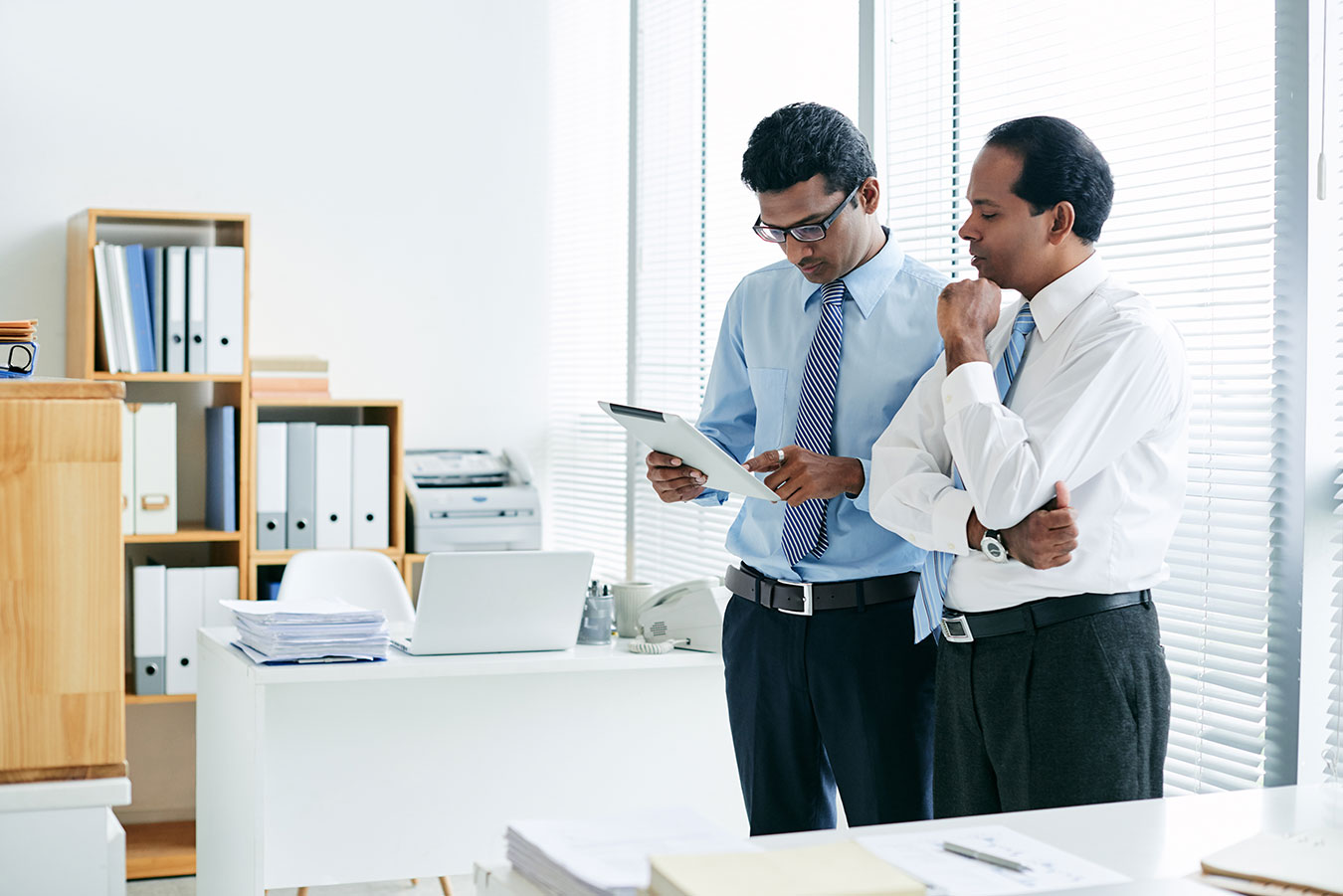 Two associates collaborating together at work