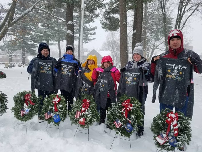 ADP's Military Strong Team laying wreaths