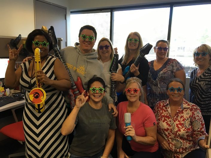 ADP-Chandler employees wearing fun, colorful sunglasses