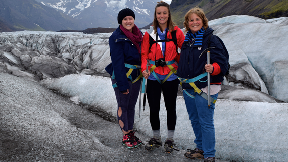 Laura, Communications Manager at Allstate, and her two daughters in cold weather hiking gear with mountains in the background