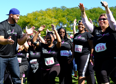 Group of Allstate employees in running gear, participating in a fundraising event.