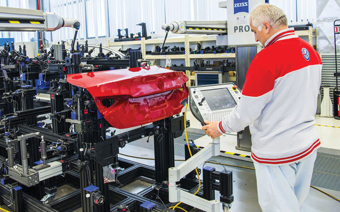 An employee ensures quality of powertrain components