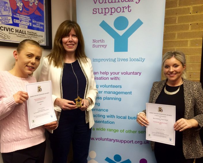 Two ADP associates presented with special recognition award for volunteering.