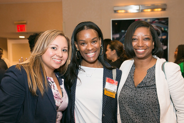 Three women pose for a photo at an ADP sponsored event.