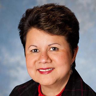 Zdjęcie twarzy Rity Mitjans, dyrektora odpowiedzialnego za różnorodność i korporacyjną odpowiedzialność społeczną.