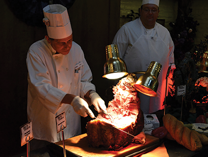Knotts Carousel Employee carving beef at Boofet