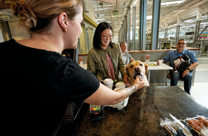 At the onsite Starbucks, a dog and his pet parent/Petco employee enjoy their treats.