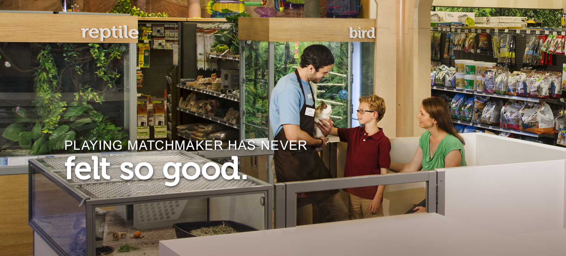"""Male Guest Experience Specialist is introducing a little boy to a bunny, while his mom looks on. Text across the image reads, """"playing matchmaker has never felt so good."""""""