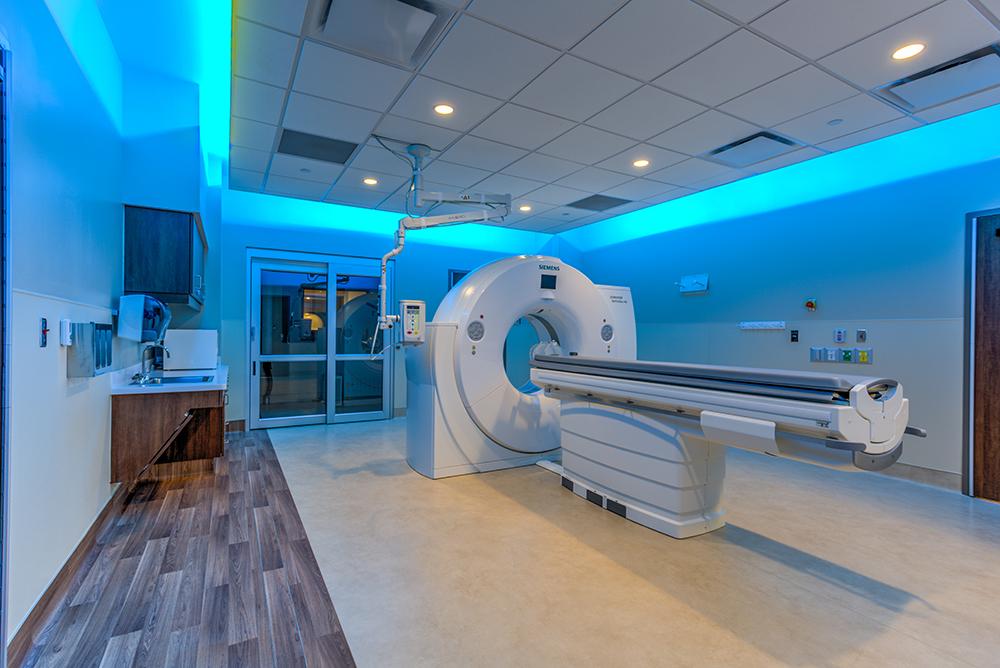 MRI machine in blue-lit room