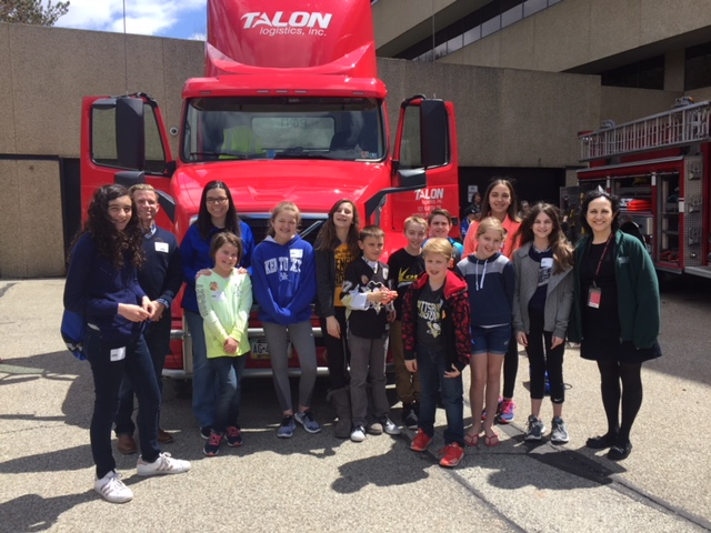 Group photo in front of Talon Truck
