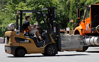 Home Depot associate operating a forklift