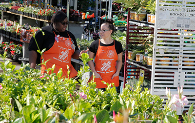 Two female Home Depot associates working in the Garden Center