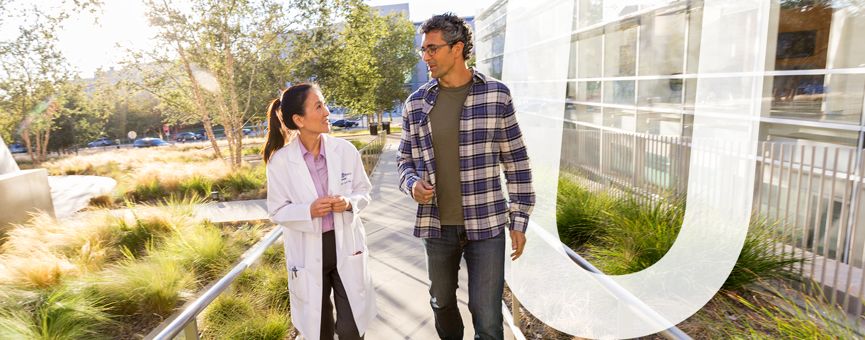 Doctor walking with patient