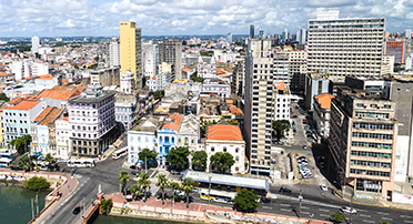 An urban city view of Recife, Brazil along the coast.