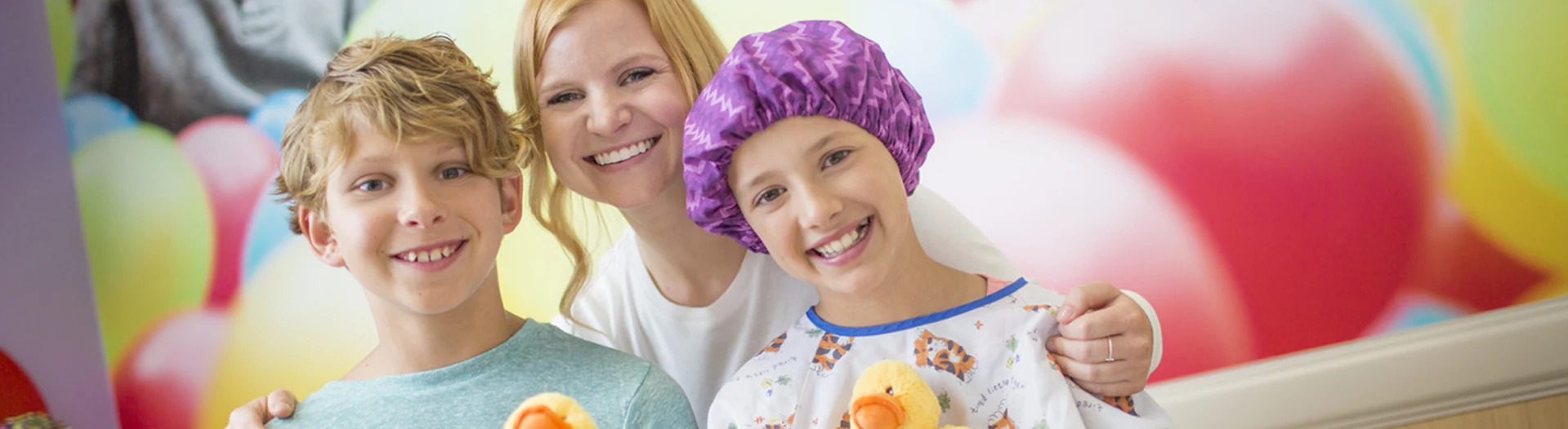 nurse with two children smiling at camera