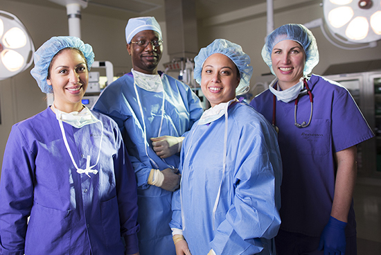 Nurses and doctors in operation theater wearing gown