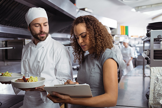 Quality analyst checking the quality of the food with checklist