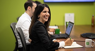 Woman at conference table laughing