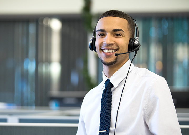 african-american team member with telephone headset