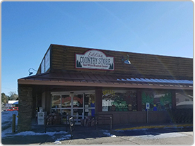 Eddie's Country Store storefront with some snow on the ground and roof.