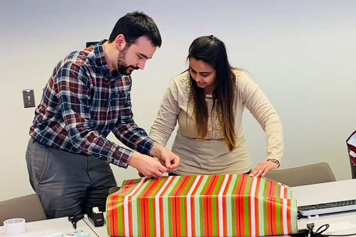 employees wrapping gifts
