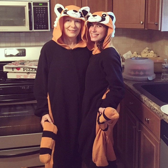 Kristin and her mom dressed in panda costumes