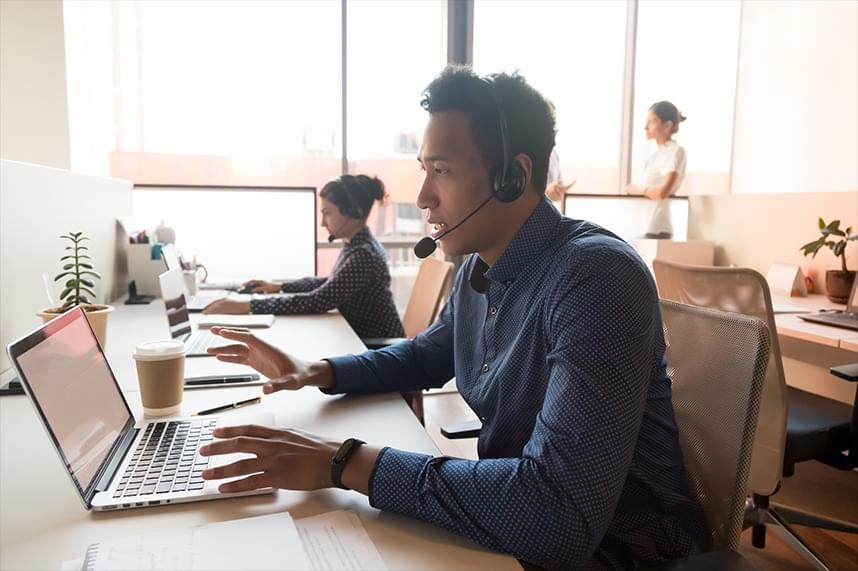 a person wearing headphones and working