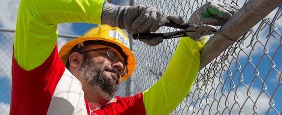 a man fixing a fence