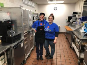 Lynn, Kitchen Lead at the Medina GetGo Cafe + Market, with one of her Kitchen Team Members