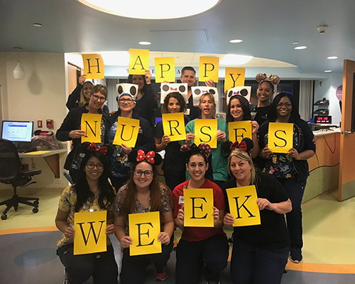 Group of nurses holding individual letters that spell out happy nurses week