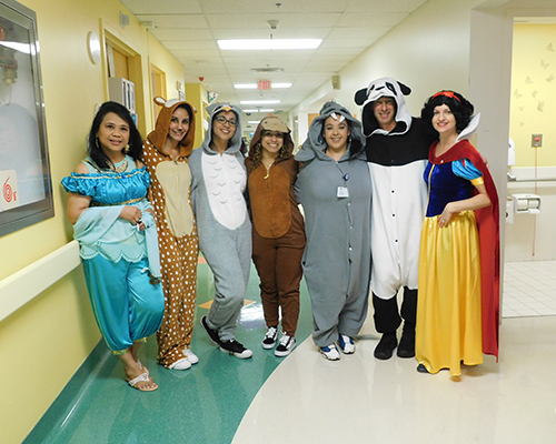 Group of nurses in various Halloween costumes